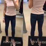 Klassikalised sinised keskmise värvliga stretch teksad